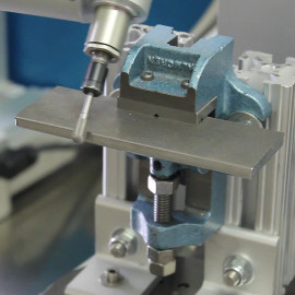 Robot chamfering plate